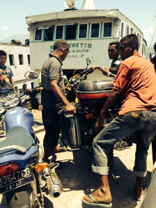 My bike being lifted onto the Lembata ferry