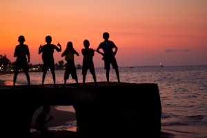 boys in Dili at sunset