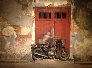 Boy on a motorcycle- street art