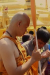 New monk collecting alms