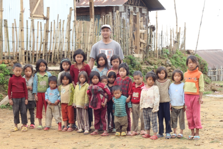 The pastor and children of the village